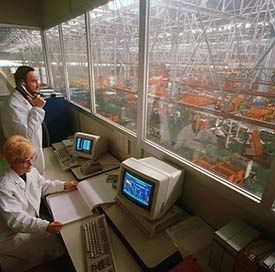 Image of two people reviewing an industrial production room.